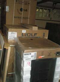Appliances in their boxes in the garage